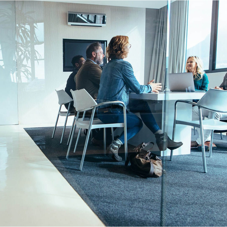 A business meeting in room with glass walls